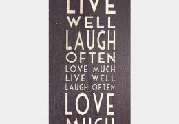 Long black sign-Live well, laugh often